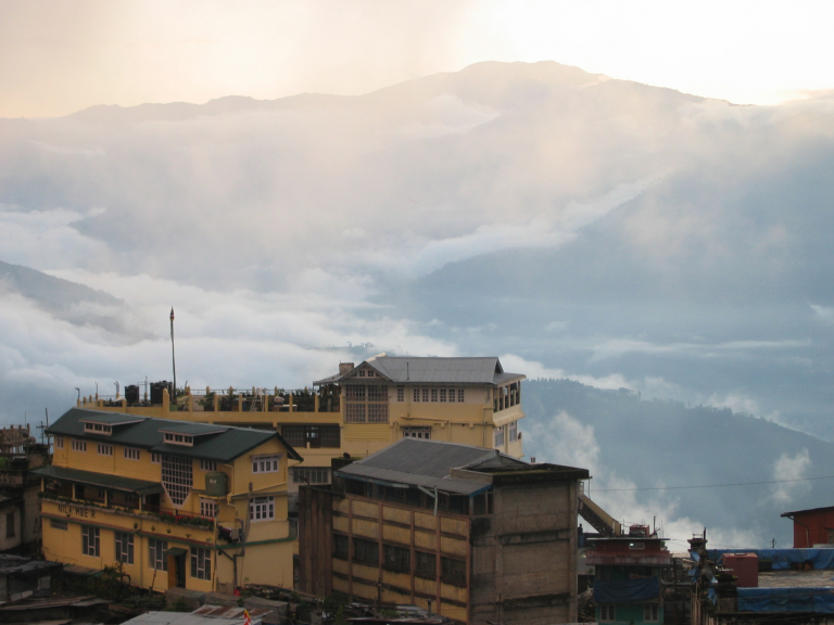 House community setting in front of mountains in Darjeeling, India