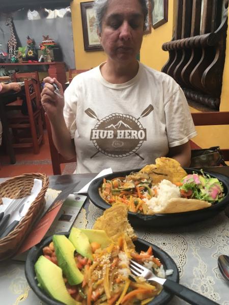 Ashima in Bogota eating local cuisine