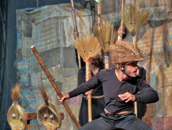 Man dancing in custom with hat and staff