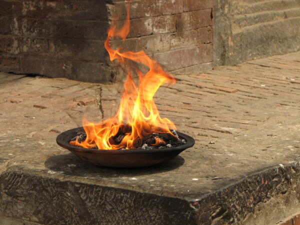 Fire burning in a medium size bowl for City of Lights in Nepal