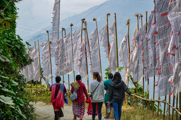 Five ladies and one child walking in the hills of Nepal