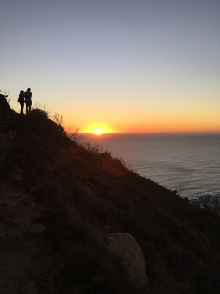 Two people enjoy looking at a South African sunset