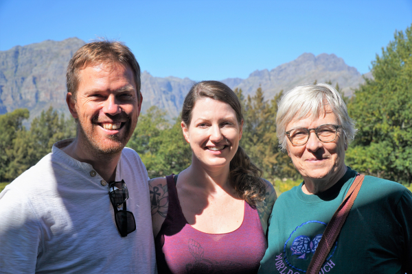 Trish with man and woman with South African mountains in the background