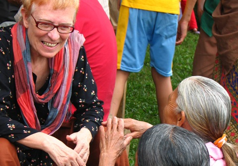Trish speaking with people while in India